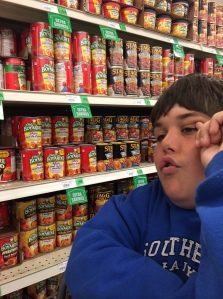 Jackson ponders the wide variety of canned beans offered at Winco.